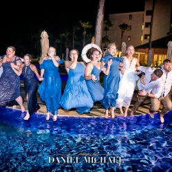 Destination Wedding Party Jumping in Pool