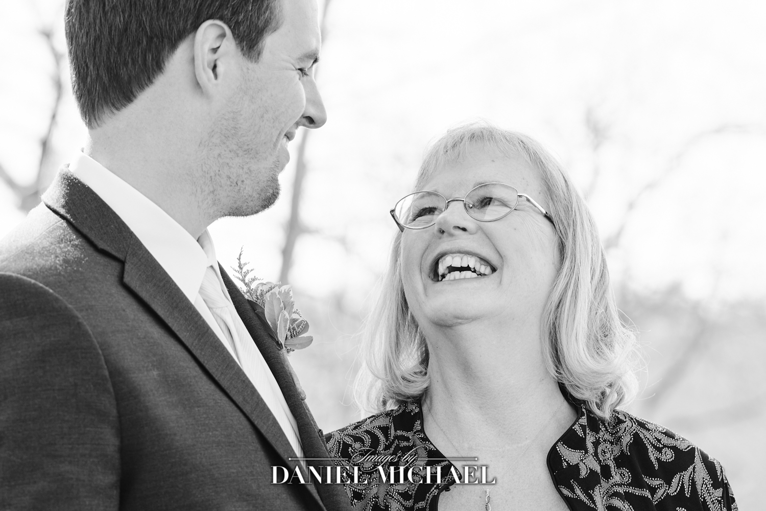 Groom and mom interaction smiling