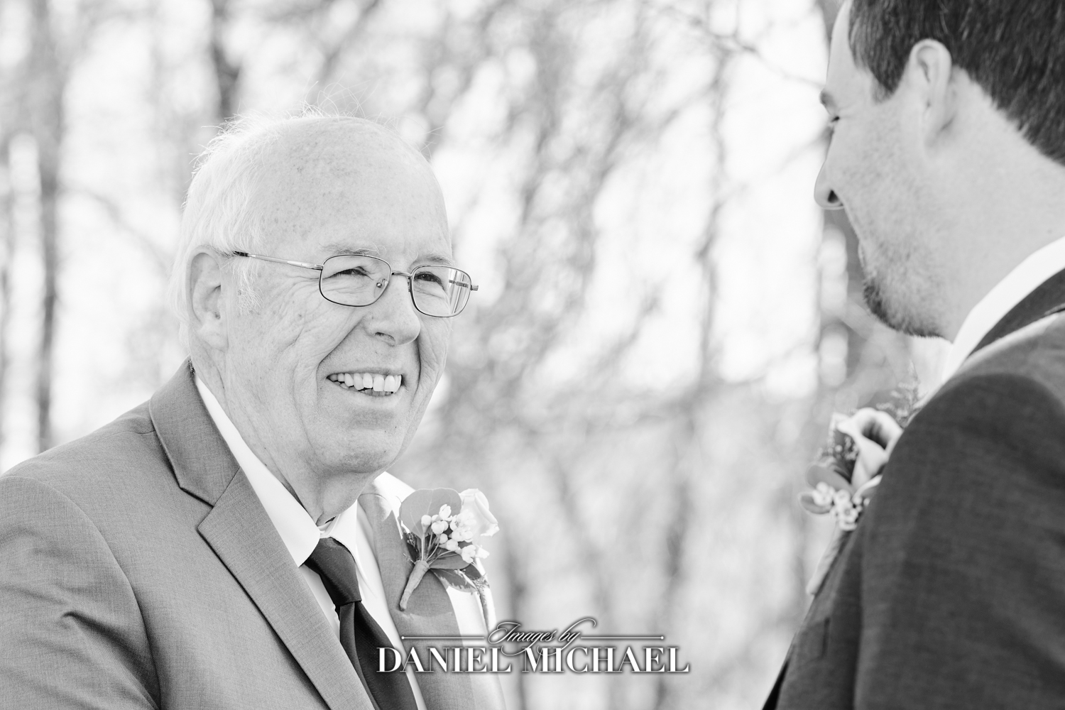 Dad Smiling at Son Shaking His Hand Wedding