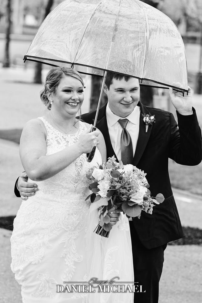Rain on Wedding Day Clear Umbrella Photo