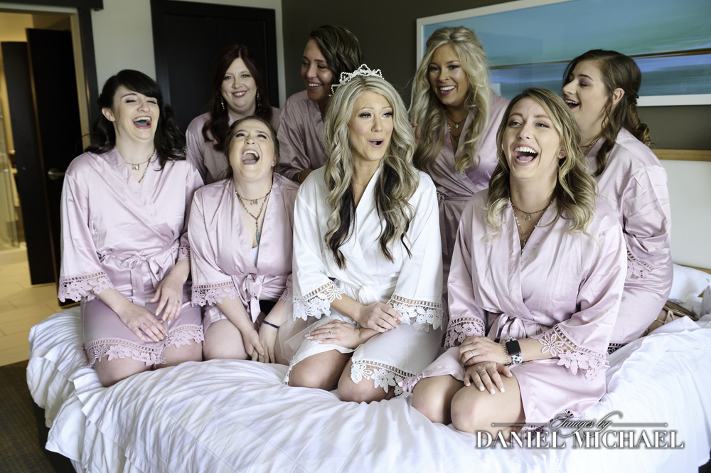 Bridesmaids on Bed in Robes