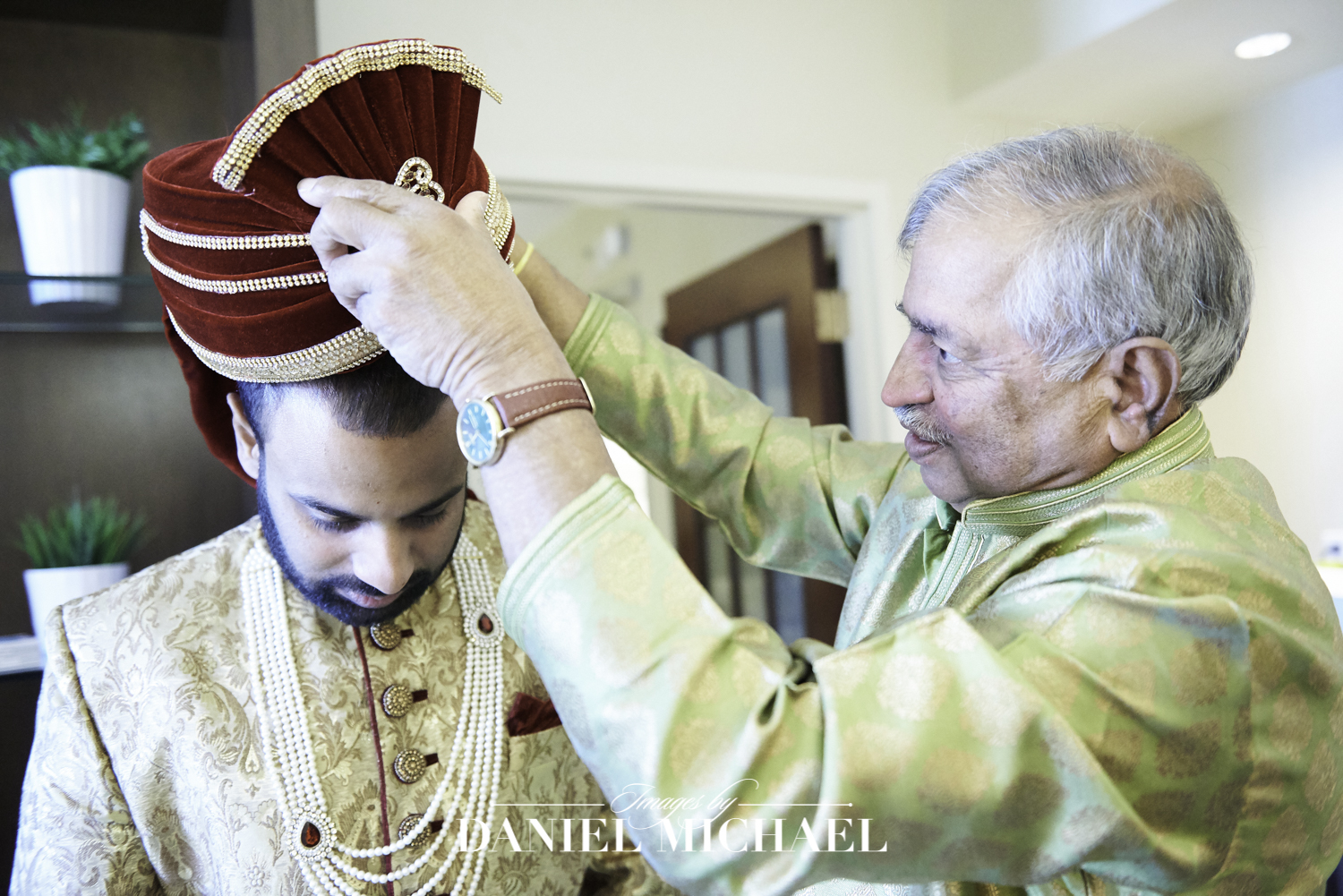 Father placing hat