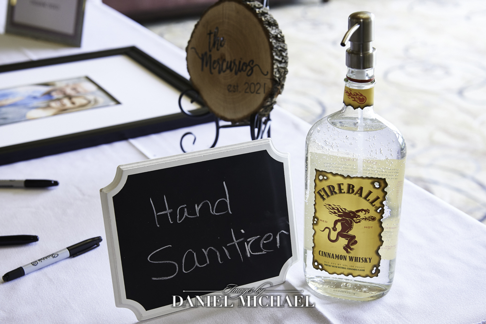 Photo of Hand Sanitizer in Fireball Bottle for Wedding