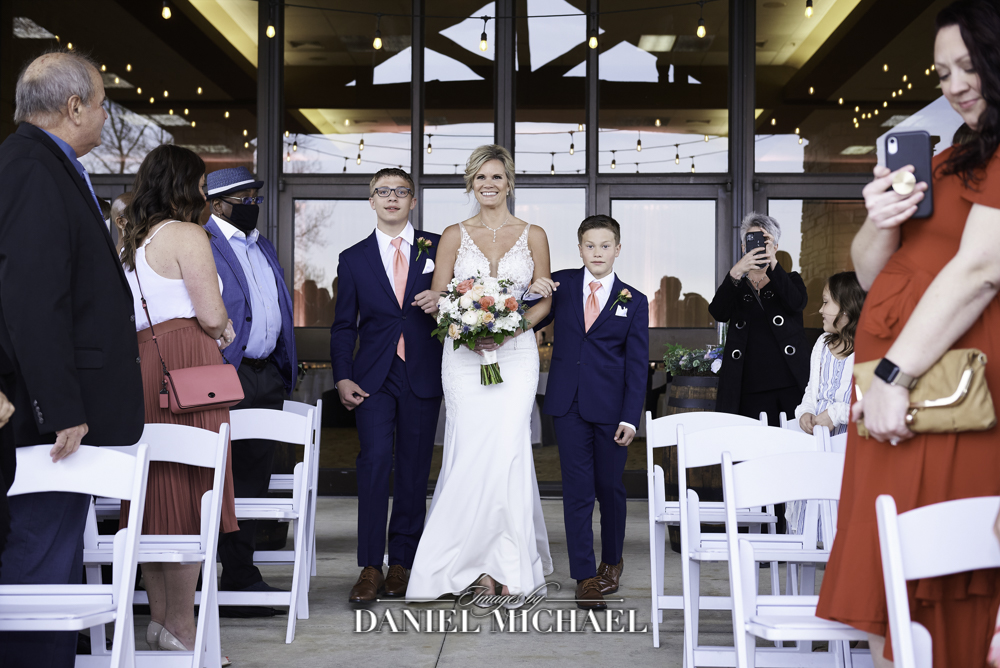 Bride Walked Down Aisle by Sons