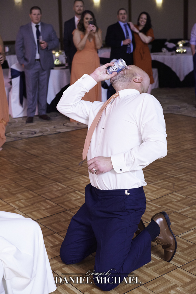 Groom Shotguns Beer at Reception