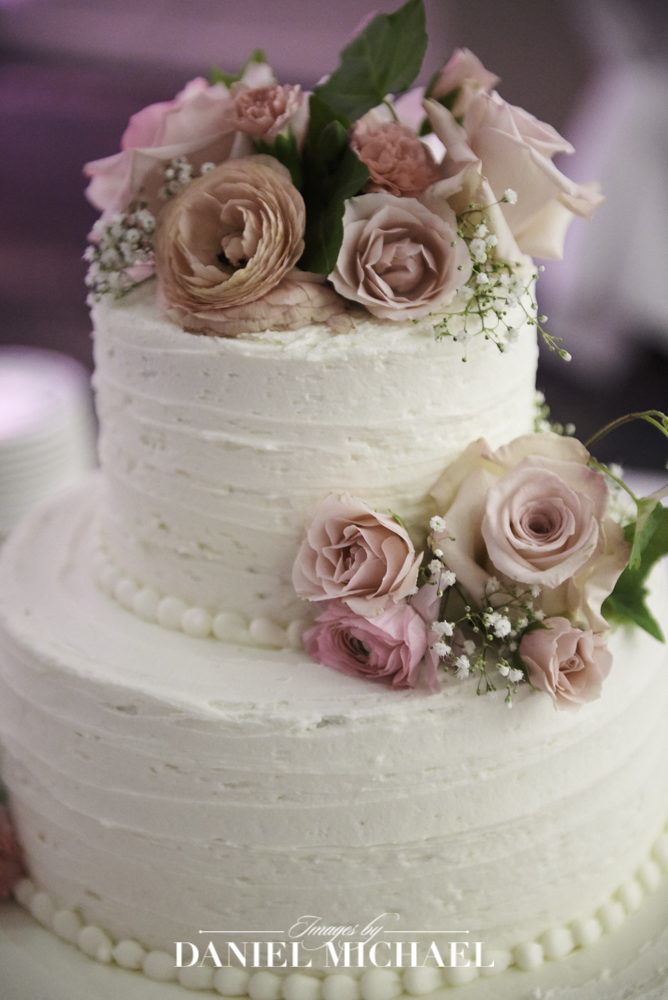 Petals and Glass Wedding Cake Photo