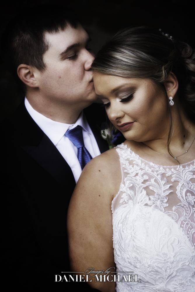Wedding Photographer capture kiss on forhead