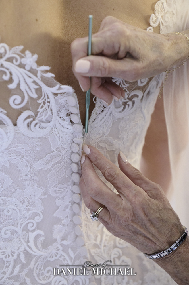 Getting into wedding dress photo