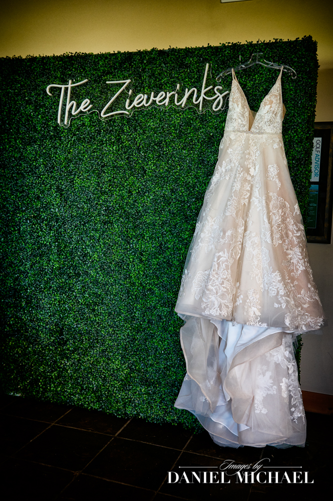 BoChic Bridal Wedding Dress hanging by personalized neon sign