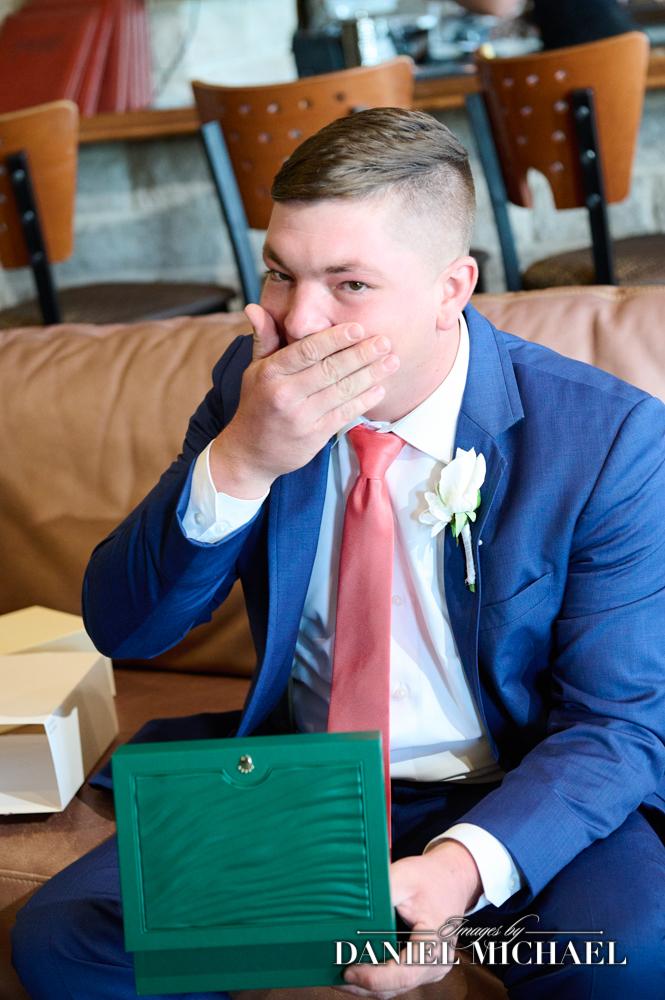 Groom reacting to Rolex