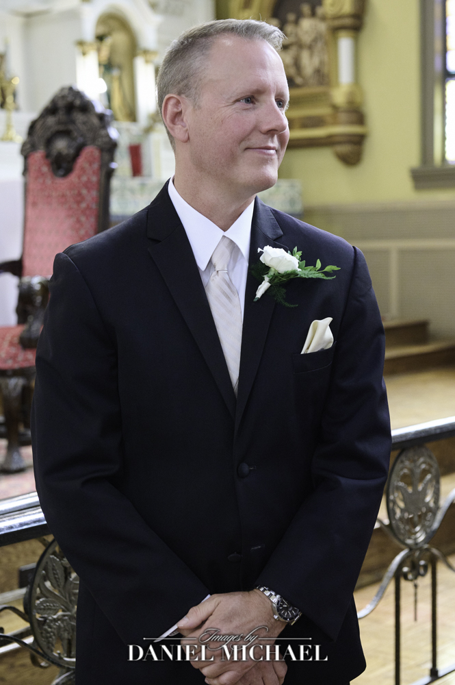 Groom's expression when bride comes down aisle