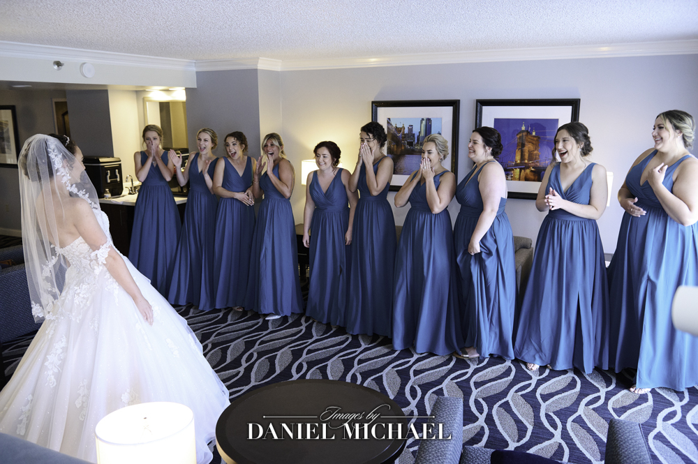 Bridesmaids Reveal of Bride in dress Photo