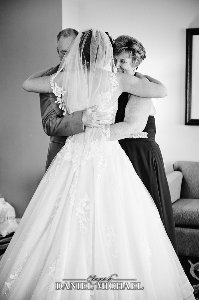 Mom and Dad hugging Bride after Getting ready