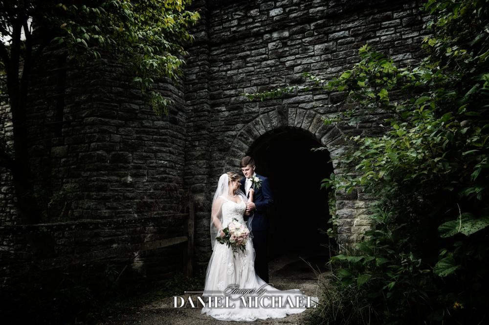Dramatic Wedding Photo by Tunnel