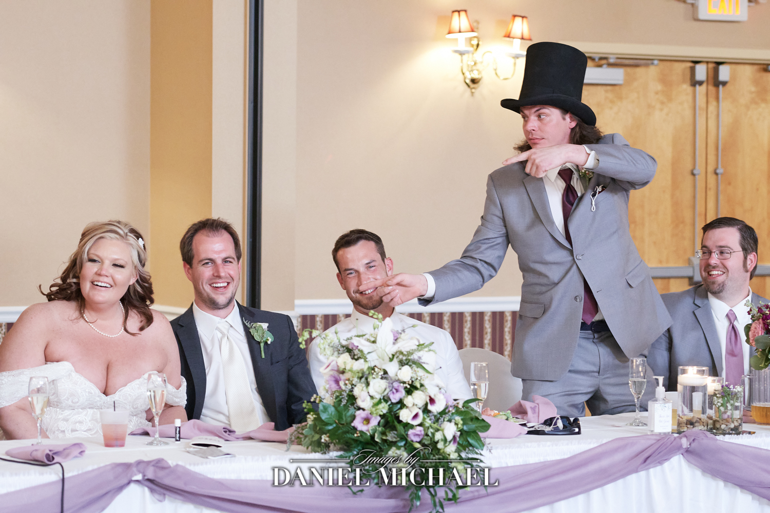 Top Hat Giving Speech at Wedding Reception