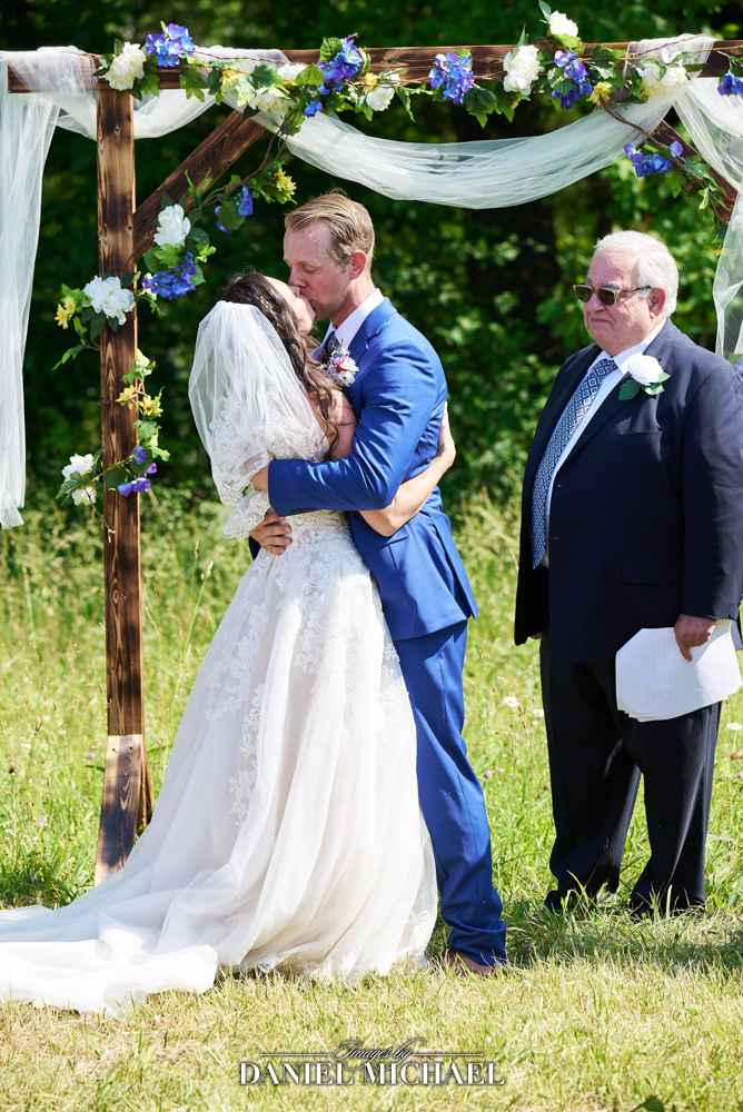 Outdoor Wedding Ceremony Kiss Photography