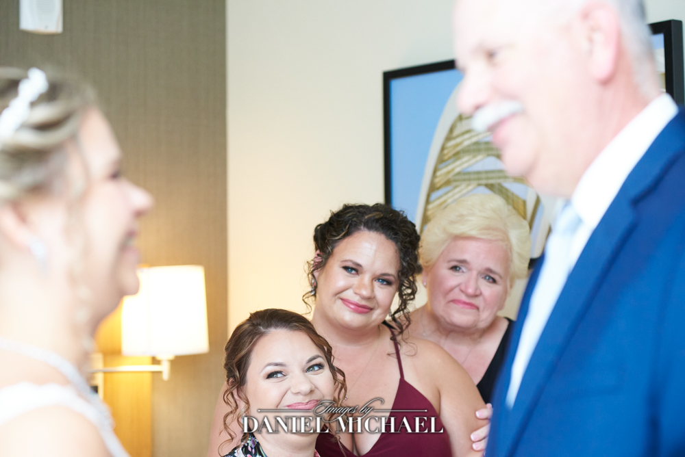 Dad Seeing Bride for First Time with Mom and Sisters