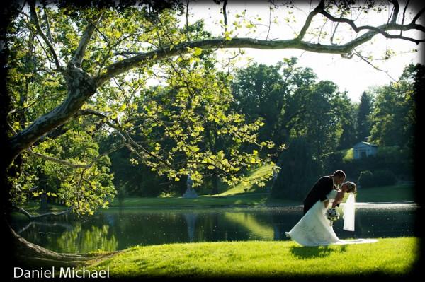 Wedding Photographers Picking up Bride